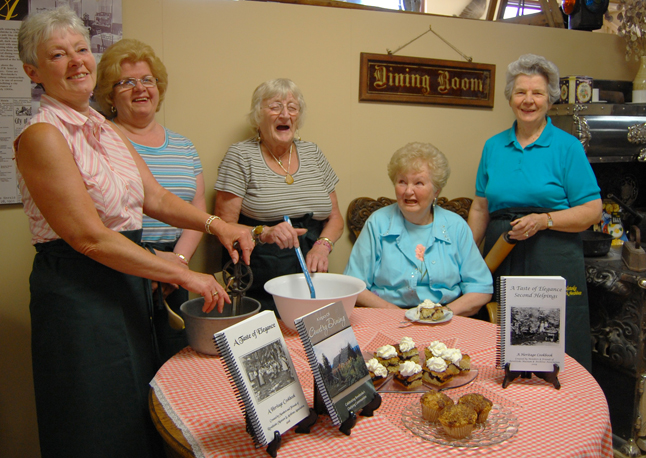 Sheryl Wolgram, Alvina Charest, Gerti Smith, Marlene Pelttari and Helen Grace share a laugh as they pose for a photo to promote their new cookbook, A Legacy of Country Dining, that the Revelstoke Museum & Archives commissioned to coincide with the 2009 Homecoming celebration this week. The book features recipes from residents who lived outside of the city limits as far south as Arrowhead. The book is being launched at the museum on Saturday at 10 a.m. Lucy Bank's coffee cakes and Gwyn Battersby's rhubarb muffins were great. David F. Rooney photo