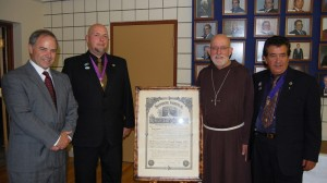 """Local Knights of Columbus celebrated their Jubilee — that's their 50th anniversary — two weeks ago with a celebratory Mass, reception and banquet at the St. Francis of Assissi Parish Hall. Their guest of honour and keynote speaker was Bishop John Corriveau (center right), head of the Nelson Diocese. The Capuchin monk spoke to the Knights and their guests about the need to """"work hand-in-hand"""" with other people to make this a better country and world. Afterwards he posed beside the Council 4712's charter with (from left to right) Revelstoke Mayor David Raven, Grand Knight-elect Blair Van Leur and Grand Knight John Suraci. David F. Rooney photo"""