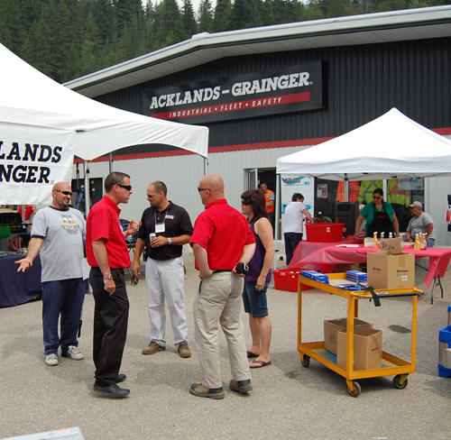 Customers and sales staff mingled at a Customer Appreciation BBQ at the Acklands Grainger centre on Highway 23N on Thursday. Representatives from several tool suppliers were on hand to show off their wares to handy people of both genders. David F. Rooney photo