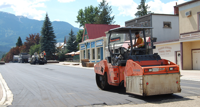 With Homecoming 2009 just two weeks away, workers from Mounce Construction are busy repaving Mackenzie Avenue. The Grizzly Plaza extension project was to have been completed by the end of June but unforeseen problems held up completion of this important project — much to the anger and disappointment of downtown merchants. However, as you can see in this photo taken today (Friday), they are almost done. David F. Rooney photo