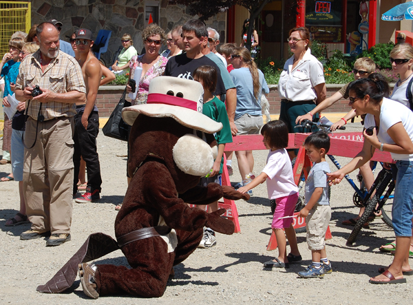 Parks Canada's beaver mascot makes a young friend during the Canada Day Parade on Wednesday. David F. Rooney photo