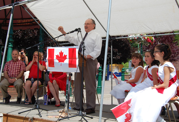 "MC Steve Beaver gets the crowd going with an ""I Am Canadian"" chant during the Canada Day ceremony at Grizzly Plaza Wednesday. David F. Rooney photo"