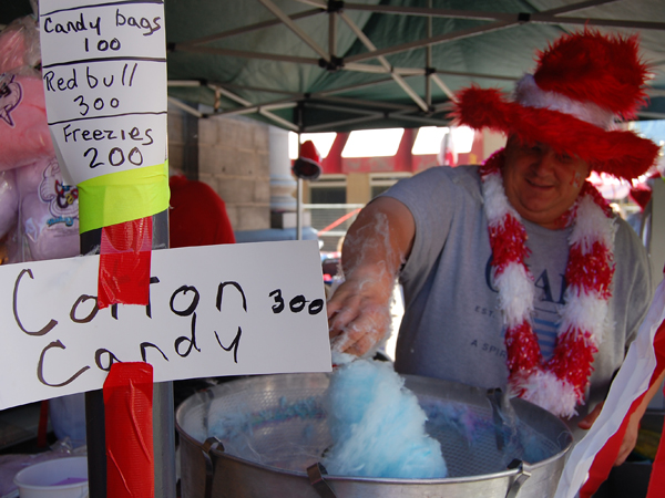 Wayne Murray of the Relay for Life's Team Gloria spins some cotton candy at Grizzly Plaza after the Canada Day parade Wednesday. David F. Rooney photo