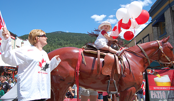 This cowboy may be very small but he sure is patriotic as he rides a plastic horse in the Canada Day Parade. David F. Rooney photo