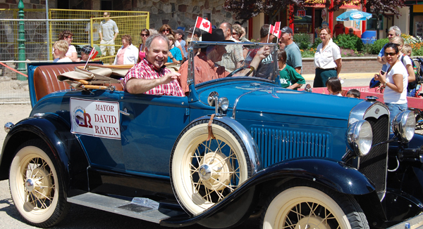 Mayor Dave Raven waves to the crowd from a vintage automobile during the Canada Day parade. David F. Rooney photo