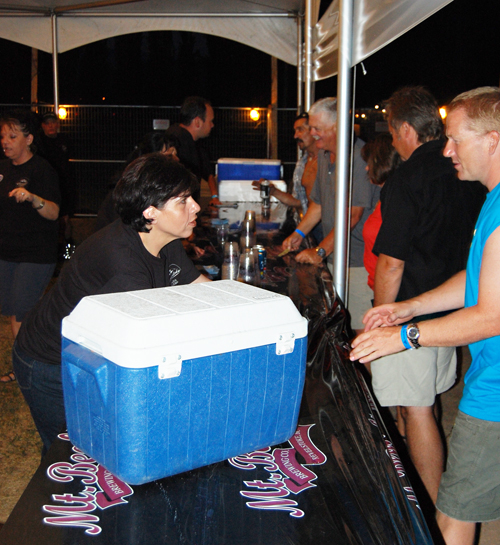 Rotarian Roberta Ciolli takes a beer order at the Revelstoke Challenge beer tent. David F. Rooney photo
