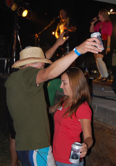 Hormones certainly seem to be in the air for this couple at the Blind Spot concert. David F. Rooney photo