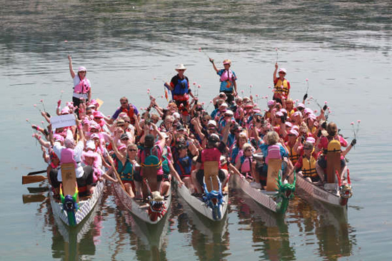 """Nine members of the Dam Survivors, the Lake Revelstoke Dragon Boat Society's racing team, joined the Imperial Dragons, a team from Salmon Arm in this group photo of 110 breast cancer survivors who competed in a race on July 4. """"The Imperial Dragons are a new team to Salmon Arm,"""" said Ginger Shoji of the Dam Survivors. """"This was their first festival and the members of our team were happy to take them into the thrill of competition. Manager Kris deVeer commented on the fact that when Dam Survivors Diane Andrews and Jennifer Wolney jumped into lead stroke position, the last race was a blast and they were on top of the world after that."""" The Dam Survivors' next race will be in Penticton on Sept. 12-13. Photo courtesy of Ginger Shoji."""