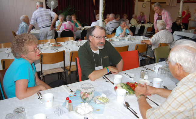 Liz and Harvie Barker talk with Paul Salva at the United Church's Homecoming dinner Saturday. Barker, for years the local United Church minister and weekly newspaper columnist, is now retired and living in Penticton. David F. Rooney photo