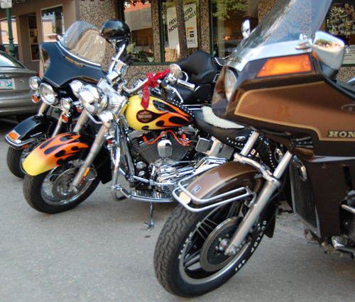 The paint fairly glowed on these bikes parked on East First Street for the 2009 Homecoming Motorcycle Show-N-Shine Friday. David F. Rooney photo