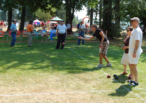 What's any kind of public picnic and festival in Queen Elizabeth Park without bocce? Here, Eric Scarcella tosses the ball. David F. Rooney photo