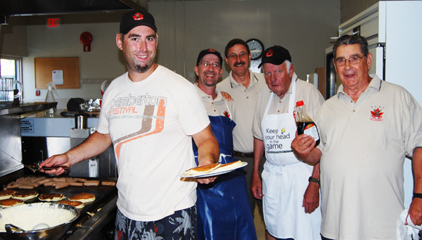 Local Elks Don Osachoff, Glen Cherlet, Todd Driediger, Clancy Boettger and Moe Tessaro pose for a quick pic at the Community Centre where they were part of the crew serving up flapjacks and sausages. Not pictured were Alan Kepler, Gary Krestinsky and John Connor. David F. Rooney photo