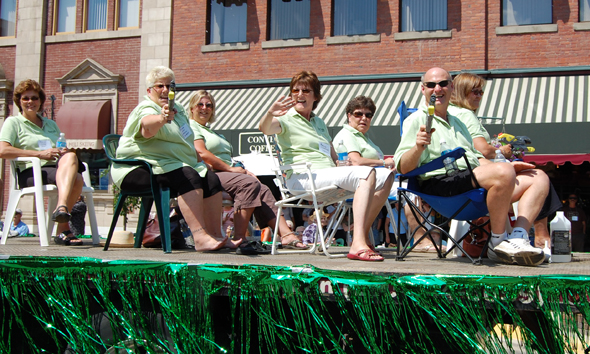 Homecoming Committee members Brenda Diebert and Alan Chell eagerly squirted the crowd watching the parade. David F. Rooney photo