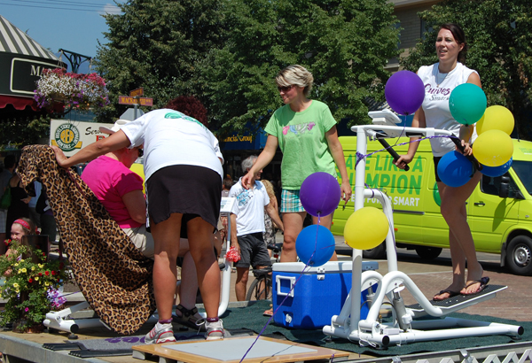 Volunteer for a parade and get a workout? Curves for Women got to it with their float. David F. Rooney photo