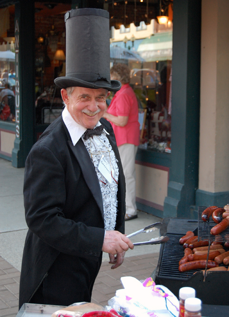 Dennis Berarducci, Revelstoke's tube steak maestro, sold his very last batches of hot dogs and smokies at Grizzly Plaza on Friday. A fixture at the corner of First and Mackenzie for more than 20 years, Berarducci has permanently retired his hot dog cart and many colourful costumes. He hopes the Revelstoke Museum might be interested in those items some day. David F. Rooney photo