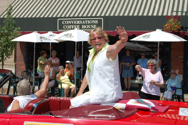Citizen of the Year Ginger Shoji waves to the crowd during the parade. David F. Rooney photo