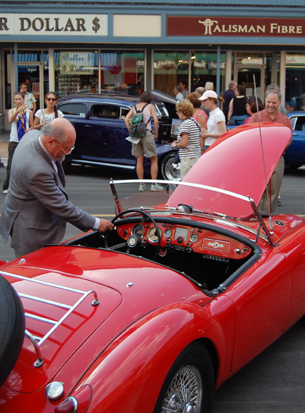 James Baring, Lord Revelstoke, can't seem to resist this red MG on display at the 2009 Homecoming Vintage Auto Show-N-Shine on Friday. David F. Rooney