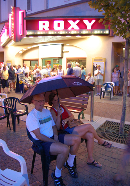 Alan and Donna MacLeod were smart: they brought an umbrella to Grizzly Plaza for the Bluetick Houn' Dogs' concert just in case it rained. And of course it did. David F. Rooney photo