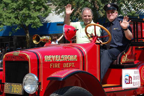 Mayor Dave Raven waves from atop a gleaming red fire truck during the parade. David F. Rooney photo