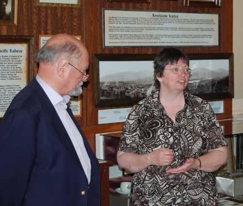 James Baring, Lord Revelstoke, listens as Revelstoke Museum Curator Cathy English speaks at the opening of a new exhibit that tells the story of Revelstoke's change of name. David F. Rooney photo