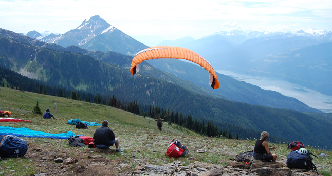 All it took was a momentary change and a paraglider took to the air Sunday morning after waiting for what seemed like an hour for the right conditions. This young woman's launch sparked more launches. David F. Rooney photo