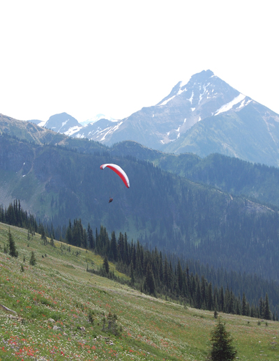A second paraglider takes to the sky, sailing through the air past Mount Cartier. David F. Rooney photo
