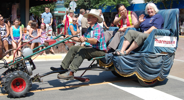 Steven Hui and Jacki Olson enjoyed a ride in a a motorized contraption during the parade. David F. Rooney photo