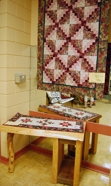 Hand-made furniture by Alpine Rustics was used to good effect in portions of the exhibition. David F. Rooney photo