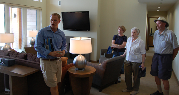 Mike Vopni of Sotheby's Canada shows visitors around the luxury condos at Revelstoke Mountain Resort's Nelsen Lodge. The lodge features three-, two-, one-bedroom and studio condos for sale. The units all come fully furnished. David F. Rooney photo