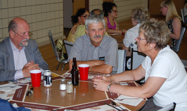 James baring, Lord Revelstoke (left), dined with City Councillor Tony Scarcella and his wife, Irene, at the St. Francis Catholic Church's dinner on Saturday. David F. Rooney photo