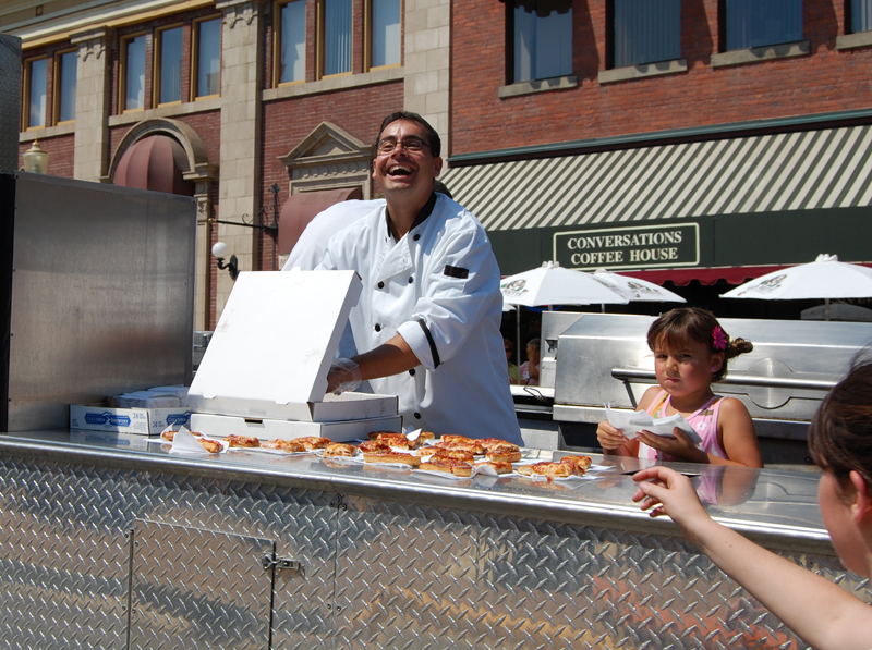 And what would you like on that pizza? The people in the Zala's float served it up fresh to kids in the crowd along the parade route. David F. Rooney photo