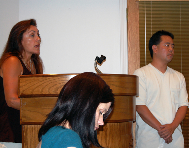 Grizzly Book Shop owner Vanessa Smith (left) speaks to Council as Intense Audio and Video owner Jason Shoji (right) listens. David F. Rooney photo