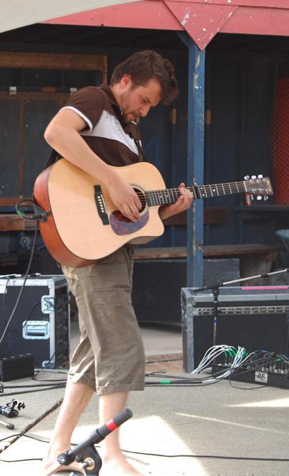 Paul Filek strums his guitar on Saturday afternoon. David F. Rooney photo
