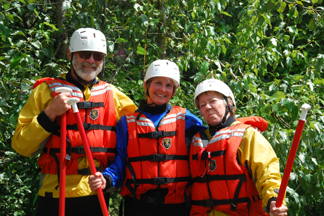 Novice rafters David Rooney, Sue Leach and Antoinette Halberstadt pose before setting out for a rafting trip down the Illecillewaet River. Photo courtesy of Apex Rafting