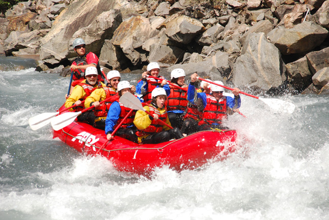 Rafters ready themselves for impact in the Illecillewaet's rapids. Photo courtesy of Apex Rafting