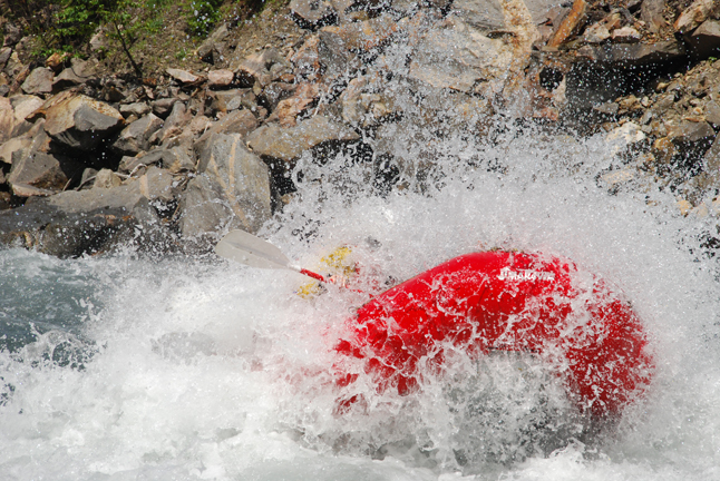 The splash says it all. Photo courtesy of Apex Rafting