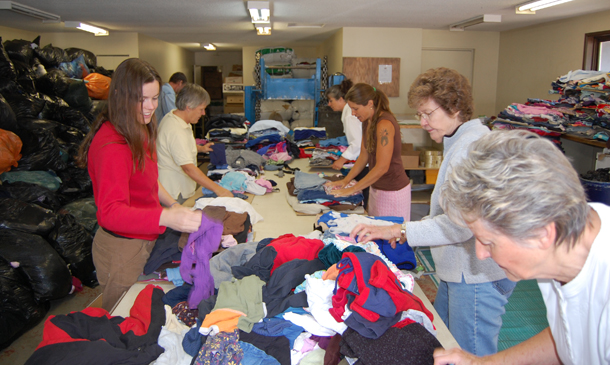 Volunteers fold and prepare used clothes being shipped to African countries of Lesotho and Swaziland and the Pacific island country of Fiji. David F. Rooney photo