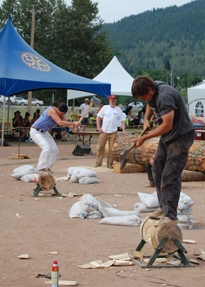 Luke Brownjohn (foreground) competes against Danielle Tkach in the butcher block chop during the second day of Revelstoke's annual Timber Days logging sports festival. David F. Rooney photo