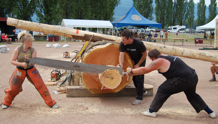 Lindsay Bett (left) of Kamloops and Chris Harris of New Zealand competed in the Jack and Jill sawing competition Sunday. David F. Rooney photo