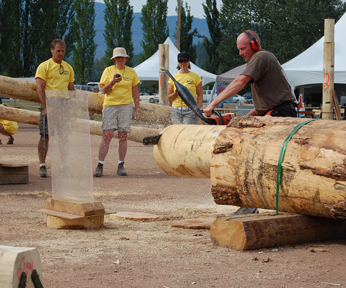 A competitor bites wood in one of the chainsaw competitions on Sunday. David F. Rooney photo