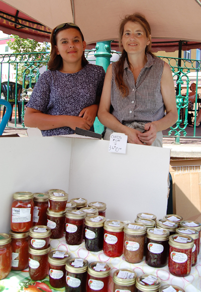 Farmer's Market Manager Janice Jarvis, shown here with her niece Melina, is also the owner of Grizzly Treats which can sate anyone's hunger for fine jams and preserves. She also offers up fresh vegetables from her own garden. When Janice is not down at the market you can reach her at 250-837-2251 or at mtllamas@telus.net. David F. Rooney photo