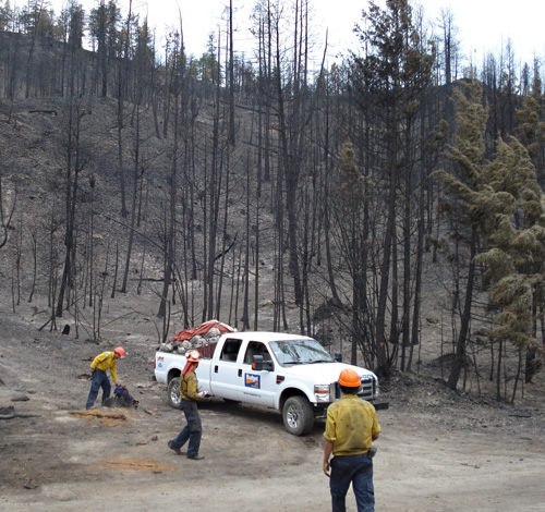 A Nakimu Ventures fire crew cleans up after a day at the Glenrosa Fire. Photo courtesy of Ben Parsons