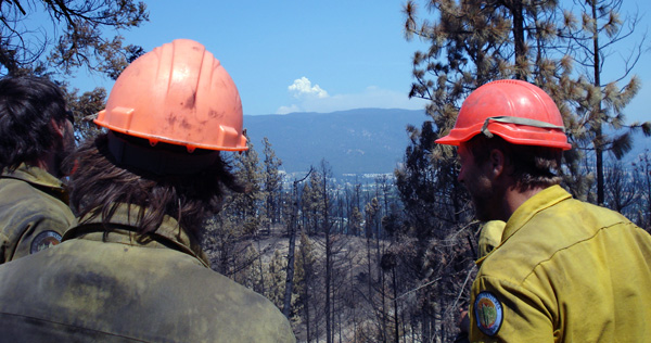 Firefighters gave out over a devastated landscape at a pyro-cumulus cloud boiling up into the sky from the Terrace Mountain Fire near Kelowna. Photo courtesy of Ben Parsons