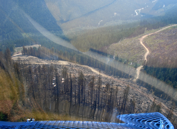 """""""They really like us to see what it looks like from the air,"""" says Nakimu crew boss Ben Parsons of this shot he took from a helicopter as he reconnoitered the Perry River Fire. Parsons had nothing but high praise for the pilots of both fixed- and rotary-wing aircraft who flew constant missions to support the men and women on the ground. Photo courtesy of Ben Parsons"""