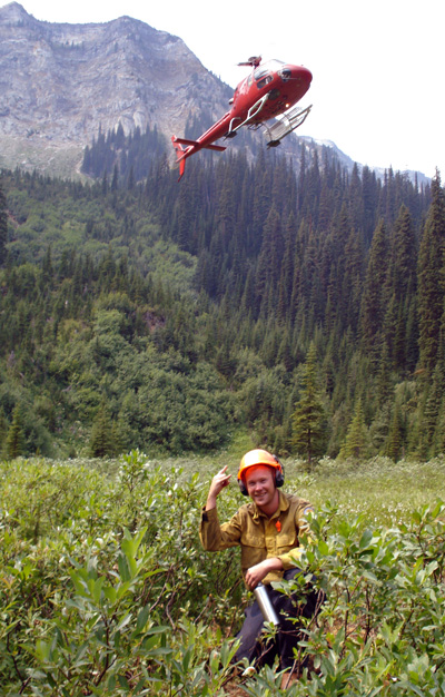 Firefighter Ryan Edwards gestures as he waits for a chopper to land with a new Nakimu crew at the Big Mouth Fire. Photo courtesy of Ben Parsons