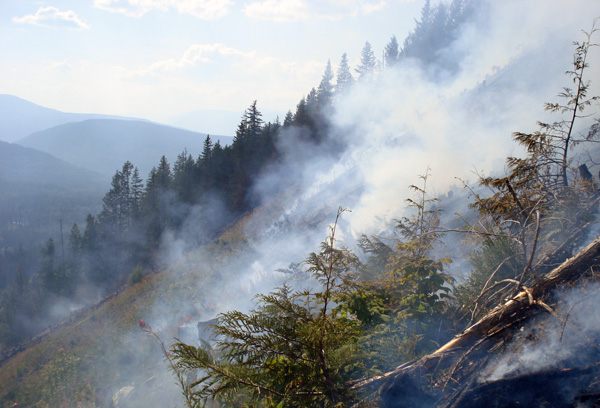 Like a landscape in Hell, smoke wreaths a slope at the French Creek Fire. Photo courtesy of Ben Parsons
