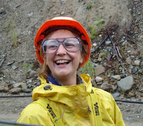 Julia, a young woman firefighter with the Nakimu crew, grins broadly at the French Creek Fire. Photo courtesy of Ben Parsons