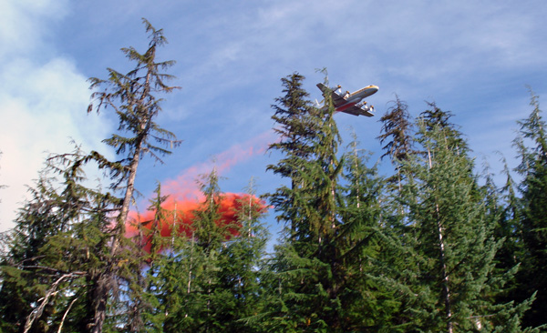 A tanker aircraft drops a load of fire retardant at Perry River. Photo courtesy of Ben Parsons