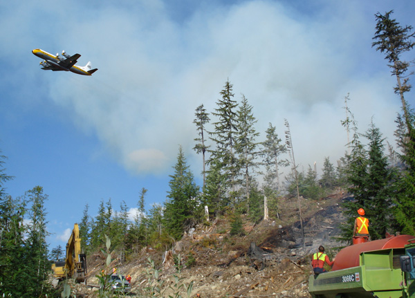 A tanker aircraft make a pass above the fire line at Perry River to give the pilot a visual sighting of the drop zone. Photo courtesy of Ben Parsons
