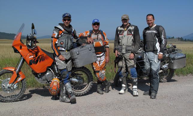 Rich Hamilton (left) and Gary DeBlock (center) pose with two friends somewhere in Montana. Photo courtesy of Robin Suopanki